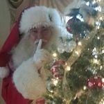 Santa behind tree