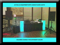 Dj euipment w lit colums and dance floor lights