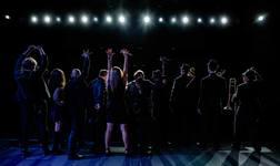 Performers onstage behind
