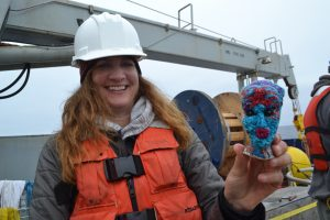 APL engineer Trina Litchendorf with her shrunken styrofoam head, recovered after a year at sea on the undervater.  Credit: M. Elend, University of Washington, V18.