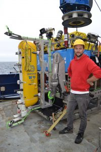 APL engineer Nic Hart next to the deep profiler loaded onto Jason. Credit: M. Elend, University of Washington, V18.