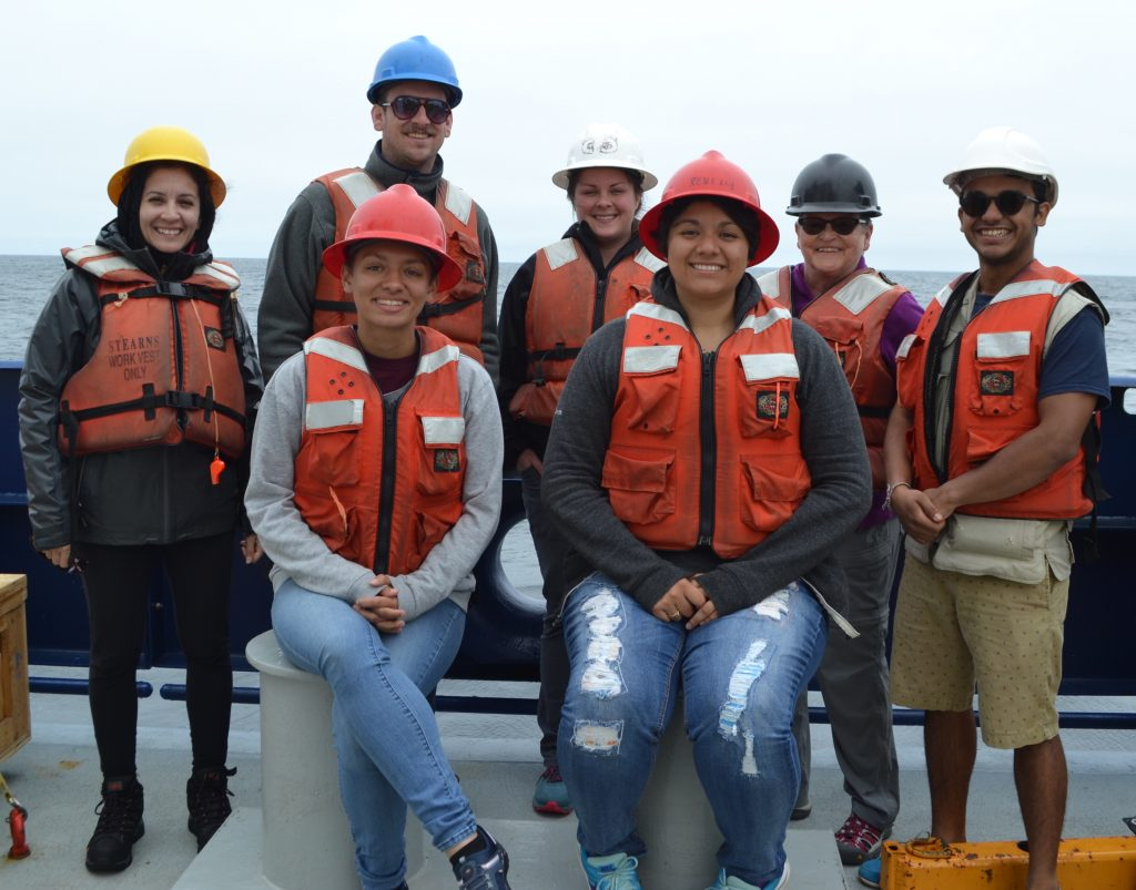 The Leg 4 VISONS18 particpants get geared up for an exciting two weeks on the R/V Revele. Front, left to right: Eve Hudson (University of Washington, undergraduate), Katie Gonzalez (University of Washington, undergraduate). Back, left to right: Romina Centurion, Evan Davis (California State Univeristy Chico, undergradaute), Jasmine Durant (Grays Harbor College, recent graduate), Julie Nelson (Grays Harbor College, professor), Yash Meghare (University of Washington, recent graduate).