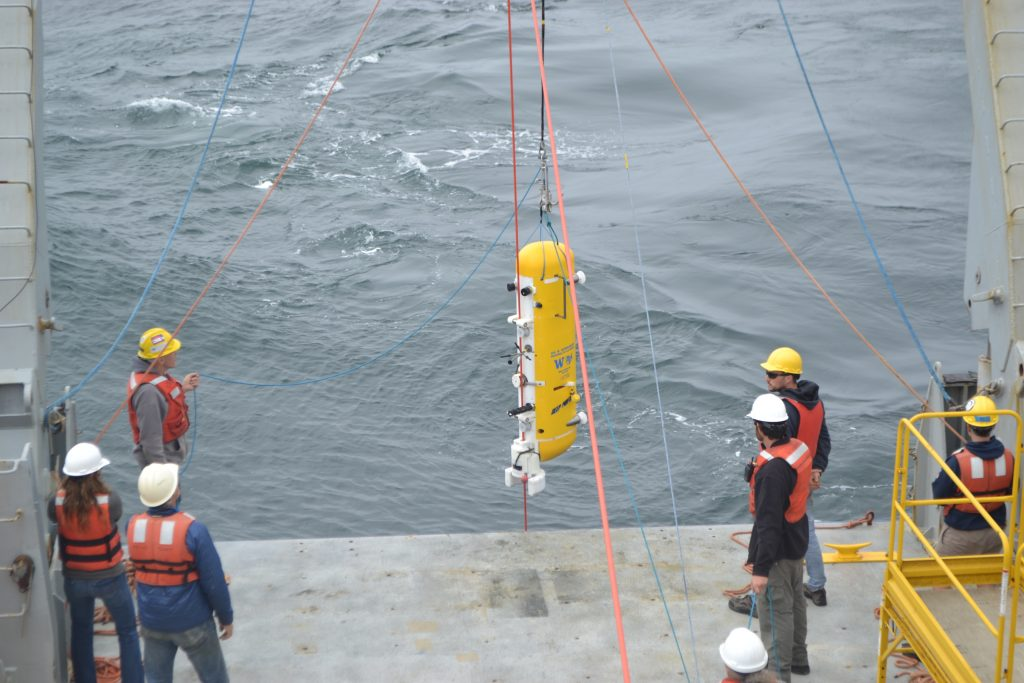 The wire crawler of the Deep Profiler at the Oregon Offshore (600 m) Site is deployed by the UW-APL Ocean Engineering Team. Credit: J. Durant, University of Washington, V18.