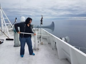 Undergraduate Katie Gonzalez helps the ship crew scrub the flying bridge. Credit: E. Hudson, University of Washington, V18