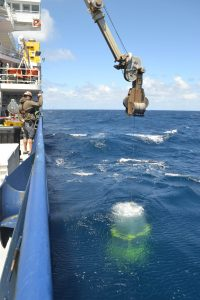 A CTD is deployed off the R/V Revelle at the Axial Base site. Here, water depth is 2600 m (8858 ft). Credit: M. Elend, University of Washington, V18.