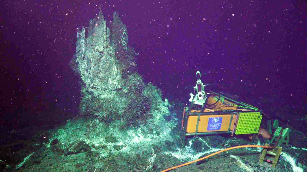 "On July 4, the OOI Cabled Array high definition camera, built by the UW, was reinstalled at the actively venting chimney ""Mushroom"" in the ASHES hydrothermal field on Axial Seamount. Credit: UW/NSF-OOI/WHOI, V18."
