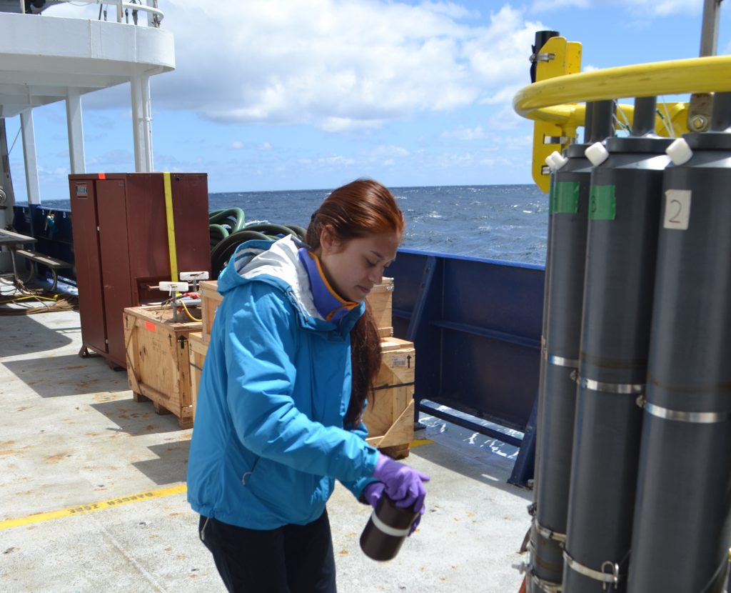 Brittany Slucher, a UW VISIONS18 undergraduate student, samples fluids from 600 m water depth for follow-on analyses. Credit: M. Elend, University of Washington, V18.