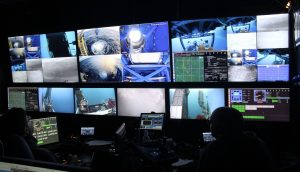 Myriad screens in the Jason contol van provide critical information to the ROV and Cabled Array teams. Credit: T. Manning, University of Washington, V18