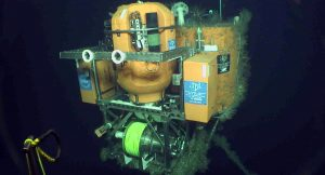 Initial view of the Slope Base Shallow Profiler Mooring on first approach with the ROV Jason (Dive1043) in 2018. The main platform was installed in 2014: the winched Science Pod is swiched out annually. Credit: UW/NSF-OOI/WHOI.