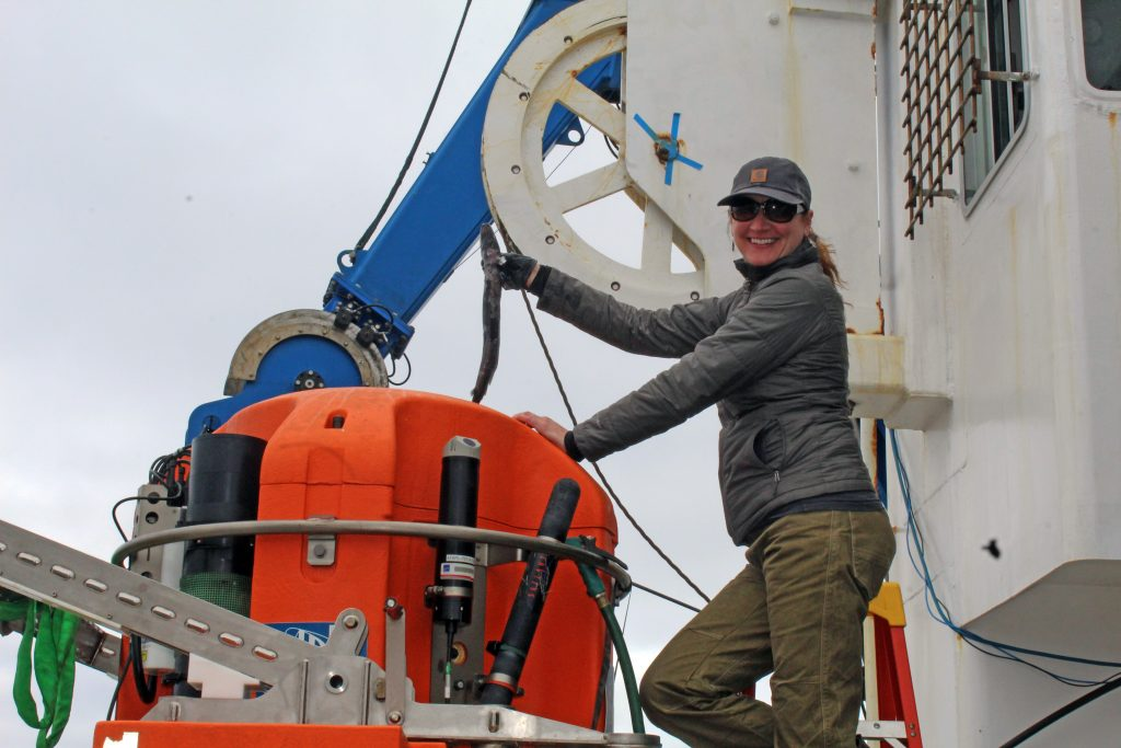 APL enginner Trina Litchendorf pulls a fish from the winched Science Pod recovered 125 km offshore during Jason Dive 1045. Credit: K. Gonzalez, University of Washington, V18.