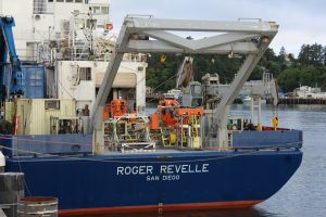 The R/V Revelle is fully mobilized and ready to to start the NSF-OOI Cabled Array 2018 expedition. Instrumented science platforms (orange) are secured on deck awaiting installation near the base of the Cascadia Margin and at Axial Seamount. Credit: Terry Manning, UW.