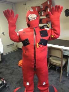 Cheryl practises putting on a survival suit as part of safety training on the R/V Roger Revelle. Credit: H. Zulaikha, University of Washington, V17.