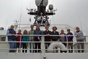 Faculty and students enjoy their first transit out of Newport, Oregon on the R/V Roger Revelle at the start of the UW-OOI-NSF Cabled Array VISIONS'17 expedition. From left to right:  Deb Kelley; Cheryl Greengrove; Hanis Zulmuthi; Kevin Eyer; Chanelle Cadot; Kevin Lally, Zach Cooper, Michelle Lee, Sasha Seroy, and Julie Nelson. Credit: M. Elend, University of Washington, V17.