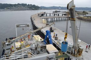 Two cranes operate to mobilize and demobilize the R/V Revelle between Legs 1 and 2 of the UW-OOI-NSF Regional Cabled Array operations and maintenance cruise. Several tons of equipment will be off- and on-loaded during the two days in port. Credit: M. Elend, University of Washington, V17.