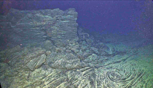 """A """"fossilized"""" whirl in a lava lake that was active during the April 2011 eruption of Axial Seamount. Credit: UW/OOI-NSF/WHOI; J2-980; V17."""