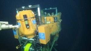 A close up view of the newly installed winched Shallow Profiler at the Oregon Offshore site. The platform is at 200 m water depth. The manipulator arm of the ROV Jason is about to pull a couple of pull pins to let the Science Pod be free. Credit: UW/OOI-NSF/WHOI.