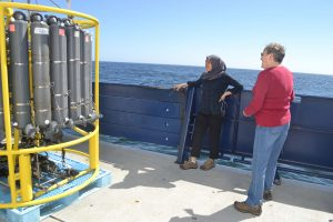 UW Oceanography student, Hanis Zulaikha, learns about the CTD from Julie Nelson, Grays Harbor College, prior to its first deployment on the VISIONS17 UW-NSF-OOI Cabled Array cruise. Credit: M. Elend, University of Washington.