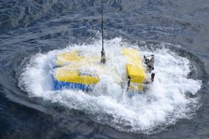 The ROV Jason enters the water for the first dive (J2970) of the UW-NSF Regional Cabled Array cruise. Credit: M. Elend, University of Washington.