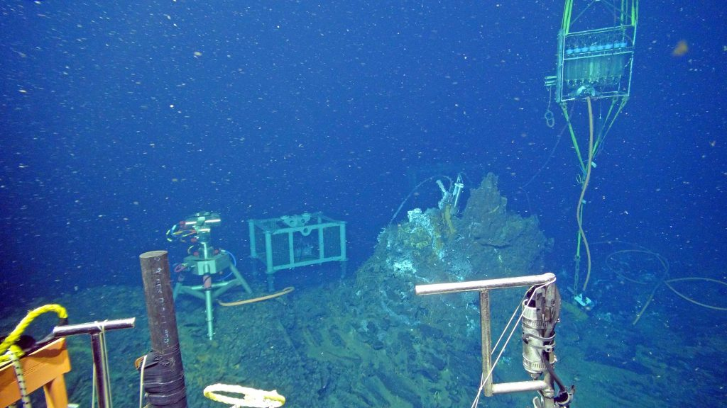 A digital still camera (left), mass spectrometer (middle) and hydrothermal fluid and microbial DNA sampler (right) document changes in animal life, gas and fluid chemistry, temperature, and chimney growth at the El Gordo vent site in the International District Hydrothermal Field at the summit of Axial Seamount - water depth is ~ 5000 ft (1500 m). Data are streaming live to shore 24/7. Credit: UW/OOI-NSF/WHOI, V16.