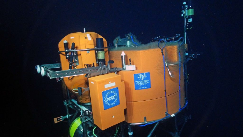 The new instrumented science pod, all bright and shiney, is installed on the Shallow Profiler Mooring at Axial Base. Credit: UW/OOI-NSF/WHOI, V16.