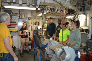Chief Engineer Paul gives Leg 2 students of tour of the R/V Thompson's shop and engine room. Credit: Joe Kalisch, Grays Harbor College, V15.