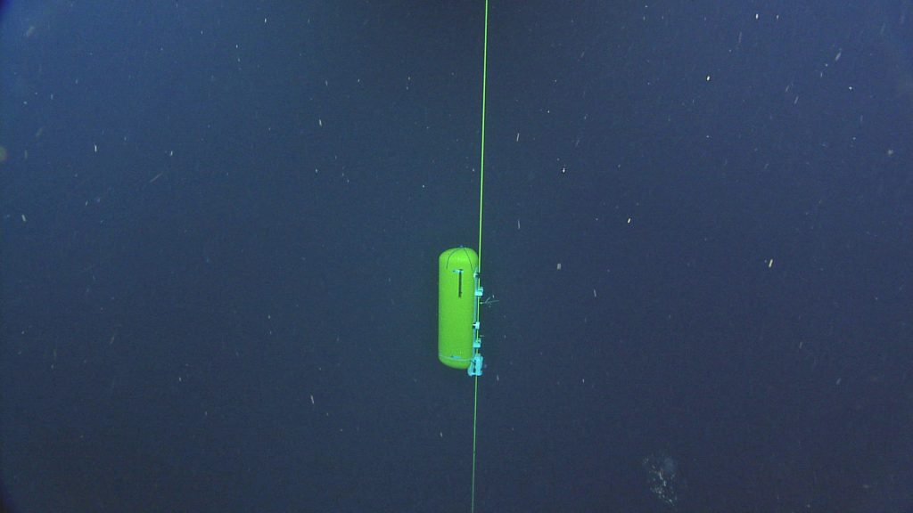 THe Oregon Endurance Offshore instrumented profiler travels down the wire on the Deep Profiling Mooring during its initial testing following installation. Credit: NSF-OOI/UW/ISS.V15, Dive R1859.