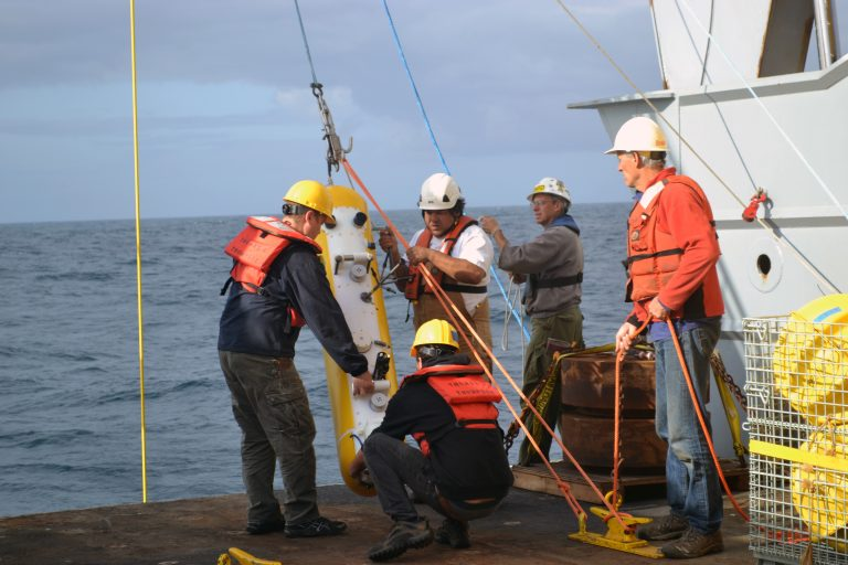The instrumented Deep Profiler is about to be attached to the mooring cable at the Slope Base Site (water depth 2900 m) during Leg 2 of the NSF-OOI-UW VISIONS'15 expedition aboard the R/V Thompson. Credit: Mitch Elend, University of Washington, V15.