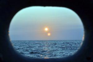 Setting sun on viewed from the R/V Thompson. Credit: Krista Nunnally, University of Washington V15