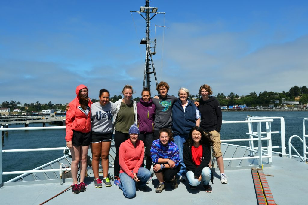 Student group photo at the end of Leg 1, VISIONS'15 cruise. Front - left to right. Jessica Noe, Jessie HIld, Diana Park. Back row  - left to right. Lauren Kowalski, Kearstin Williams, Malea Saul, Kadijah Homoka, Jesse Turner, Chief Scientist Debbie Kelley, Katie Bigham. Credit: Julie Nelson.