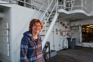 Katie smiles - It is good to be back out at sea onboard the R/V Thompson on the VISIONS'15 expedition. Credit: Lauren Kowalski, University of Washington.