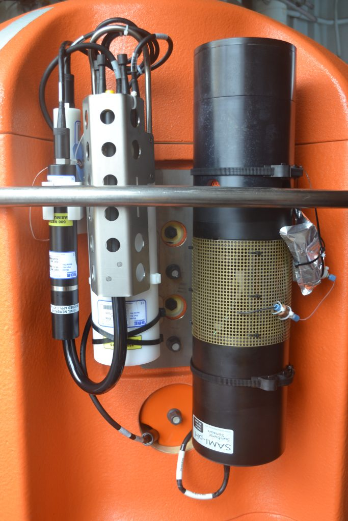 The CTD is sensor in the middle, between the SUNA nitrate sensor (right) and SBE43 oxygen sensor (left).  	Photo credit: Mitch Eland, UW