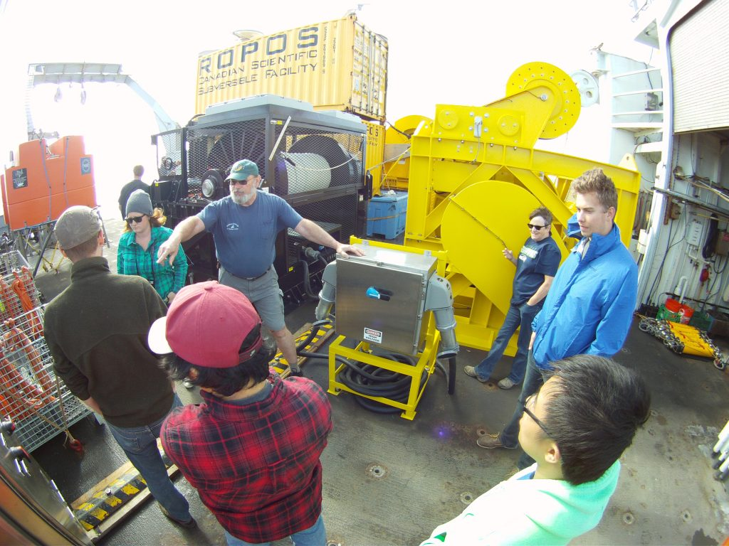 Skip Denney provided the students of Leg 5 a tour of the fantail which included a detailed explanation of all of the parts to the vertical moorings and a descriptrion of the equipment utilized in the deployment of it.  	Photo Credit: Colin Katagiri, University of Washington, V14