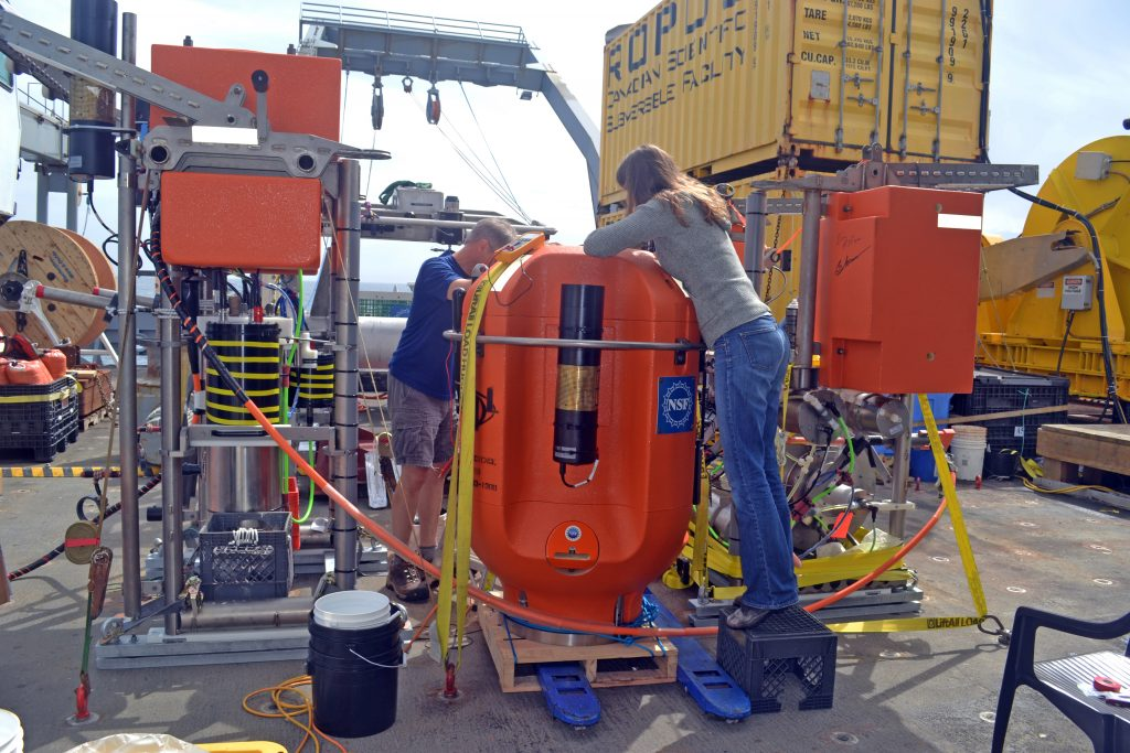 Orest Kawka (RSN School of Oceanography Project Scientist) and Trina Litchendorf (RSN APL Engineer) work on the EA Oregon Offshore Shallow Winched Profiler, and Instrument Platform on the fantail of the R/V Thompson. Photo Credit: Mitch Elend, University of Washington; V14.