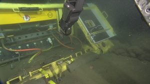 Primary node PN1C at Endurance Offshore was deployed in a trawl-resistant frame, including doors over the connection points. ROPOS cut through the straps and opened the doors in preparation for laying cable RS01W9 from PN1C to LV01C.  Photo Credit: NSF-OOI/UW/CSSF, Dive R1743, V14