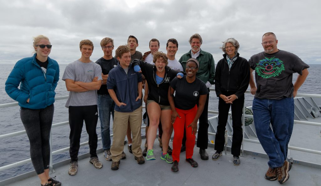 Leg 2 VISIONS'14 students gather with Chief Scientist John Delaney and Co-Chief Scientist Kendra Daly on the upper deck of the R/V Thompson for a final group image. Photo Credit: Ed McNichol, University of Washington and © 2014 Mumbian Enterprises, Inc. V14