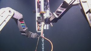 ROPOS connecting cable AXVMW4 and strain relief to the junction box on the Deep Profiler mooring at Axial Base.  Photo Credit: NSF-OOI/UW/CSSF, Dive 1742, V14