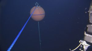 A line attached from the top float of the Axial Base deep profiler mooring to the winch on ROPOS, prior to a recovery to diagnose and repair the mooring connector.  Photo Credit: NSF-OOI/UW/CSSF, Dive 1740, V14