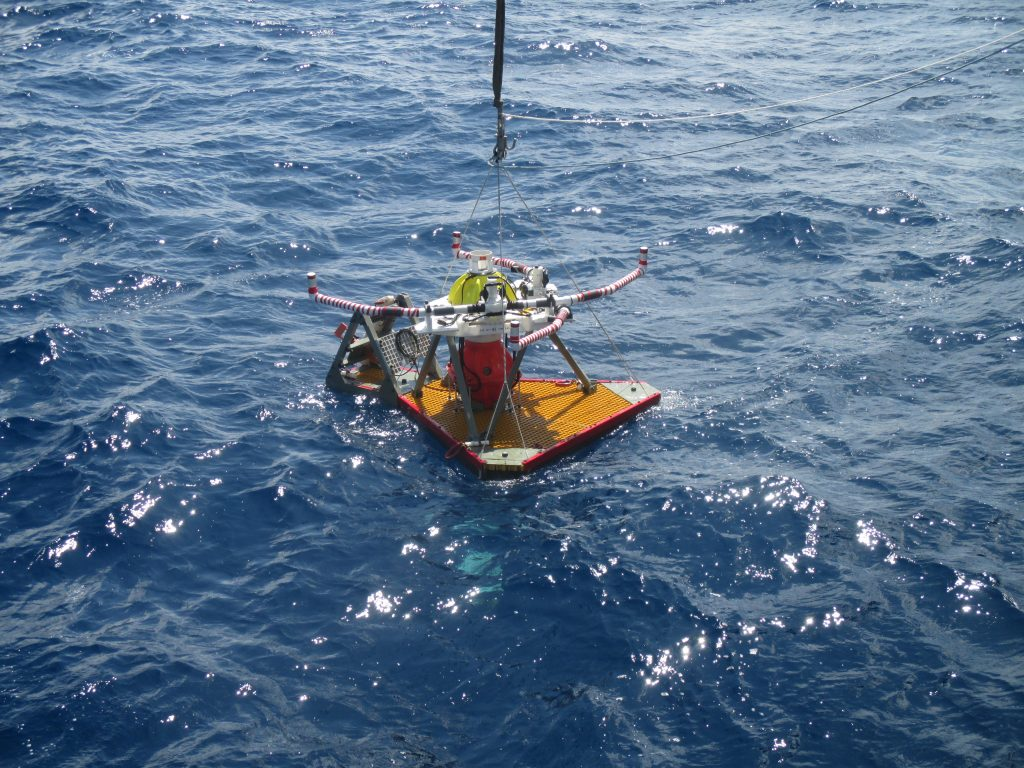 The HPIES experiment about to be dropped to the seafloor from the surface. It is kept balanced by a series of weights attached to the bottom, so the equipment doesn't tip over on its way down.