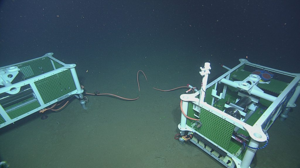 An overhead shot showing the spatial relationship between junction box LJ01A and low-voltage node LV01A at the Slope Base site.  	Photo Credit: NSF-OOI/UW/CSSF; Dive 1735; V14.