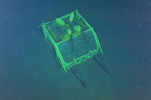 An overhead shot from ROPOS hovering above the Slope Base Primary Node, PN1A. Photo Credit: NSF-OOI/UW/CSSF; Dive R1733; V14