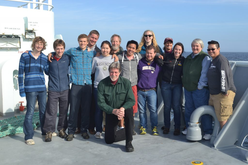Students and educators for Leg 1 of the VISIONS'14 Expedition. Front: Chief Scientist John Delaney and Co-instructor for the UW Ocean 411 Class - Sea Going Research and Discovery. Left to right: Katie Bigham, Sam Albertson, Jesse Turnder, Gina Hansen, Don Setiawan, Charles Garcia, Krista Nunnally, Deb Kelley (Co-Chief Scientist and Co-instructor for Ocean 411), and Christina Ramirez. Back row left to right: Friedrich Knuth, John Wonderly (Clallam Bay School), Caitlin Russel, and Leslie Sautter (College of Charleston). Photo Credit. Mitch Elend, University of Washington.