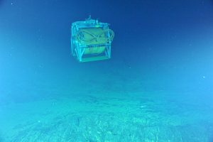 The ROCLS cable drum a few meters above the seafloor as it is being lowered by the R/V Thompson's trawl wire. The drum contains >15,000 feet of extension cable. Photo credit: NSF-OOI/UW/CSSF; Dive 1727; V14.