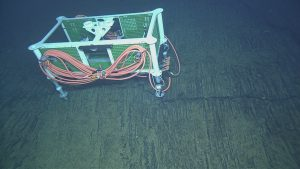 During ROPOS Dive R1724, the junction Box MJ03F was deployed at the Central Caldera Site. It will host a broadband seismometer, a low-frequency hydrophone, and a bottom pressure-tilt instrument suite. Photo credit: NSF-OOI/UW/CSSF; Dive R1726; V14.