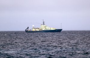 Our sister ship, the R/V Atlantis, working 1.5- to 3-km away from us at the summit of Axia Seamount during the first week of VISIONS'14. The Atlantis effort is focusing on the ASHES hydrothermal field, where we installed an underwater high-definition camera and 3D temperature array last year. Photo Credit: Ed McNichol, Mumbian Enterprises, Inc., V14