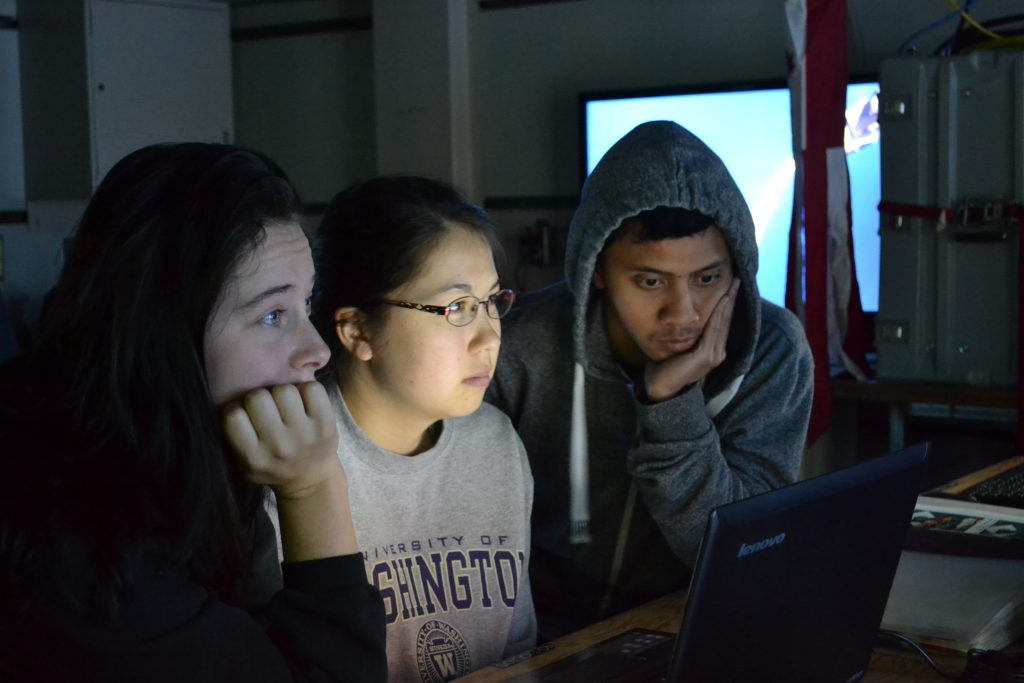 Krista Nunnnally, Gina Hansen, and Don Setiawan watch ROPOS operations in the ROPOS control room during Dive R1712. Photo Credit: Mitch Elend, University of Washington, V14.