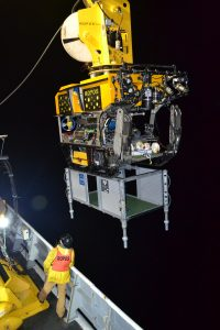 The remotely operated vehicle (ROV) ROPOS begins its first science dive at Axial Seamount of VISIONS'14. An empty junction box is attached beneath the ROV's 'belly'. Photo Credit: Mitch Elend, University of Washington, V14.