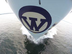 The bow of the R/V Thomas G. Thomson slices through the waters of the Juan de Fuca Strait, initiating Leg 1 of VISIONS '14. Photo credit: Christina Ramirez, University of Washington, V14.