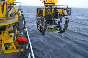 """On the transit out to Axial Volcano, a short stop was made to conduct a """"Dunk Test"""" with the ROV ROPOS to ensure all was ready to go upon arrival at Axial Seamount. Image Credit: Mitch Elend, University of Washington, V14."""