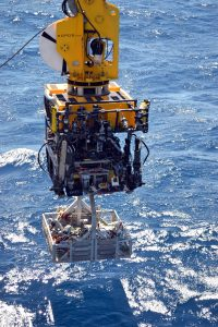 With ROPOS's heavy lift capabilities and industry style latch system on its underbelly, it is able to safely take heavy loads to the seafloor. During the VISIONS'13 Expedition, ROPOS takes two short-period seismometers to the seafloor in the tool basket at the start of Dive 1617 to the caldera of Axial Seamount.