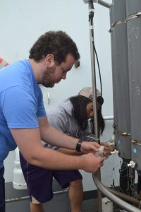 I got to collect fluid samples with Colin from the Niskin bottles on the CTD for follow-on shore-based analyses. Photo Credit: Mitch Elend